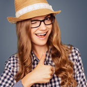 Portrait of a smiling young woman with casual garb winking and   — Stok fotoğraf