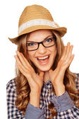 Portrait of a surprised young model in a hat and glasses with mo — Stock Photo