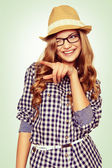 Portrait of a cute young woman with casual garb pointing to the — Photo