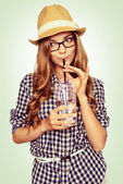 Portrait of a cute young woman with casual garb drinking water t — 图库照片