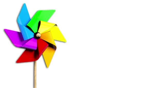 Molinete de arco iris girando en el viento con alfa — Vídeo de stock