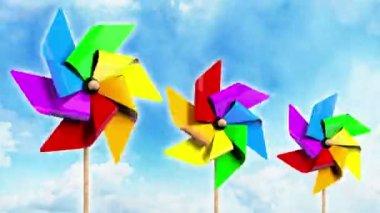 Gökkuşağı gökyüzü üzerinde Pinwheels iplik — Stok video