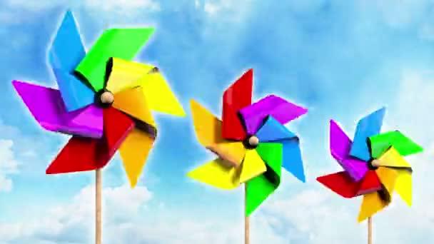 Arco iris girando molinetes en el cielo — Vídeo de stock