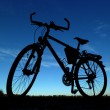 Royalty-Free Stock Photo: Bike silhouette in front of a blue sky