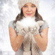 Christmas woman blowing snow — Stock Photo #14952515
