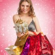 Woman with Christmas gifts — Stockfoto