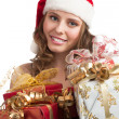 Santa woman with Christmas gifts — Stock Photo #14953377