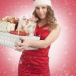 Santa woman with Christmas gifts — Stockfoto