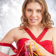 Woman with Christmas gifts — Stock Photo #14953389