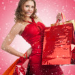 Woman with Christmas gifts — Stock Photo