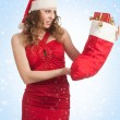 Santa woman with Christmas gifts — Foto de stock #14953653