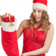 Surprised woman with Christmas socks — Stock Photo