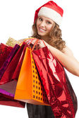 Santa Woman with shopping bags — Stock Photo