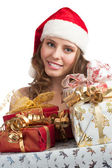 Santa woman with Christmas gifts — Stock Photo