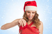 Santa woman with Christmas gift — Stock Photo