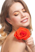 Woman with rose and beautiful make-up — Stock Photo