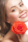 Beautiful woman with rose — Stock Photo