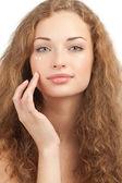 Beautiful woman applying moisturizing cream — Stock Photo