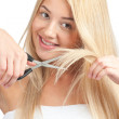 Woman cutting her hair with scissors — Stock Photo #15323533