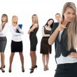 Confident business woman with colleagues standing in the backgro — Stock Photo