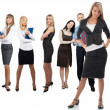 Confident business woman with colleagues standing in the backgro — Stock Photo #15521221