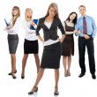 Stock Photo: Confident business woman with colleagues standing in the backgro