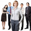 Confident businesswoman smiling with colleagues standing in the — Stock Photo