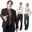 Smiling businessman and his team - Stock Photo