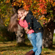 Beautiful couple kissing in autumn park — Stock Photo