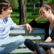 Royalty-Free Stock Photo: Couple sitting together on park bench