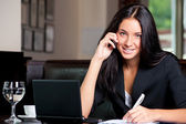 Business woman on cell phone — Stock Photo