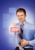 Businessman pushing on a button — Stock Photo