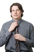 Businessman adjusting his necktie — Stock Photo