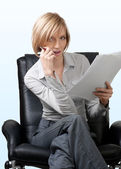 Pensive businesswoman with documents — Stock Photo