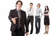 Smiling businessman and his team — Stock Photo
