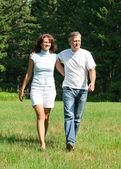 Happy beautiful couple in park — Stock Photo