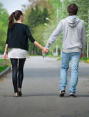 Young couple walking together in park — Stock Photo