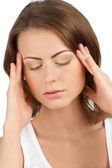 Young beautiful woman having a headache — Stock Photo