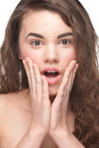 Young woman looking surprised — Stock Photo