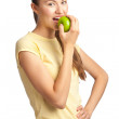Royalty-Free Stock Photo: Woman eating green apple