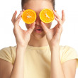 Woman with two halves of orange - Stock Photo