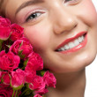 Smiling woman with roses - Stock Photo