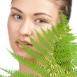 Beautiful woman with green leaf — Stock Photo #15535651