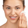 Young woman cleaning her face — Stock Photo #15535741