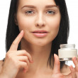 Beautiful womapplying moisturizing cream — Stock Photo #15539385