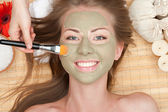 Woman with clay facial mask — Stock Photo