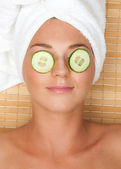 Woman with facial mask of cucumber — Stock Photo
