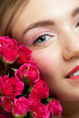 Young beautiful woman with roses — Stock Photo
