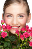 Smiling woman with roses — Stock Photo