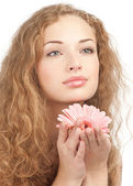 Beautiful woman with flower in her hands — Stock Photo